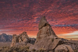 Beautiful sunset with colorful orange and purple clouds setting over the natural rock formations of City Of Rocks National Reserve, in Southern Idaho, no people, large jpeg