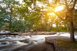 Beautiful Swedish creek at the sunset