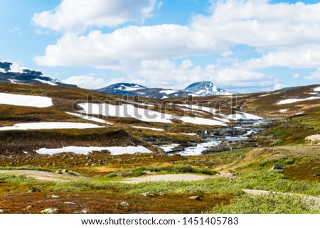Beautiful Swedish snowy mountain landscape in northern Sweden called Stekenjokk and is located along the Wilderness Road  #1451405783