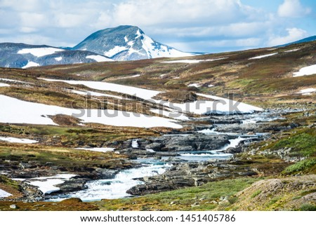 Beautiful Swedish snowy mountain landscape in northern Sweden called Stekenjokk and is located along the Wilderness Road  #1451405786