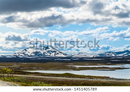 Beautiful Swedish snowy mountain landscape in northern Sweden called Stekenjokk and is located along the Wilderness Road  #1451405789