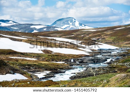 Beautiful Swedish snowy mountain landscape in northern Sweden called Stekenjokk and is located along the Wilderness Road  #1451405792
