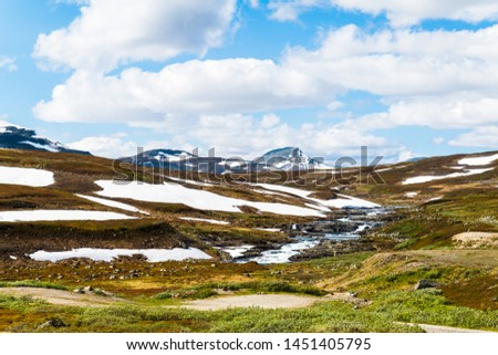 Beautiful Swedish snowy mountain landscape in northern Sweden called Stekenjokk and is located along the Wilderness Road  #1451405795