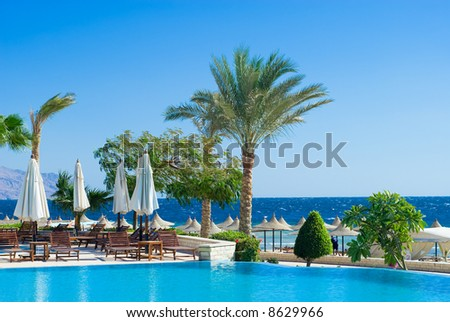 beautiful swimming pool and ocean in background