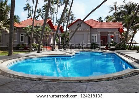 Beautiful swimming pool at luxury tropical  resort
