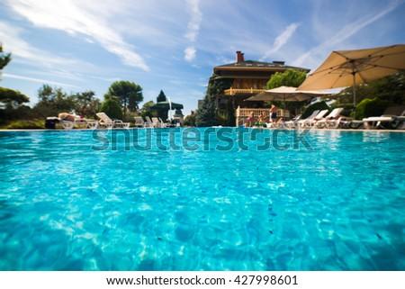 Beautiful swimming pool in tropical resort , close up #427998601