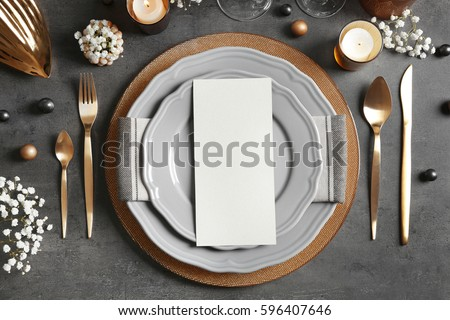 Beautiful table setting on grey background Photo stock ©