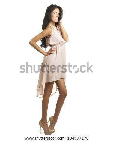 Beautiful tall long legged model wearing gorgeous dress.  Image isolated against white background.