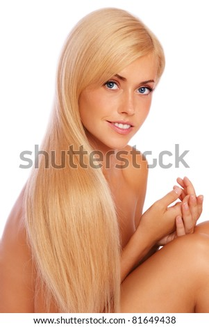 Beautiful tanned slim sexy girl with long blond hair on white background