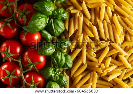 Shutterstock Beautiful tasty colorful pattern of italian pasta, tomatoes and basil. Top view. Abstract. Food concept.