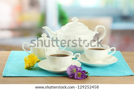 Beautiful tea service on wooden table