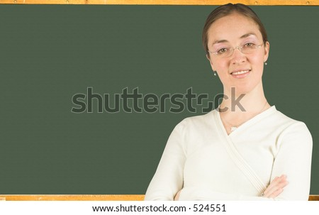 beautiful teacher in front of a black board