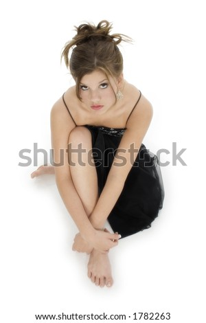 stock photo : Beautiful teen girl barefoot in black formal over white.