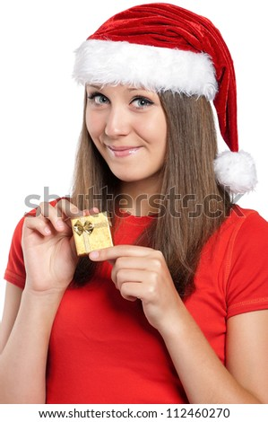 Beautiful teen girl in Santa hat with gift box posing on white background
