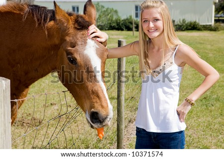 stock photo : Beautiful teen girl on the farm with her horse.