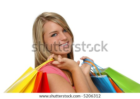 Beautiful teen girl shopping and smiling on a white background - stock photo
