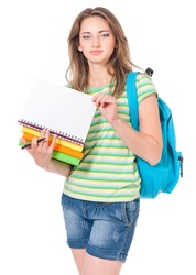 Beautiful teen girl with backpack and books, holding white blank isolated on white background
