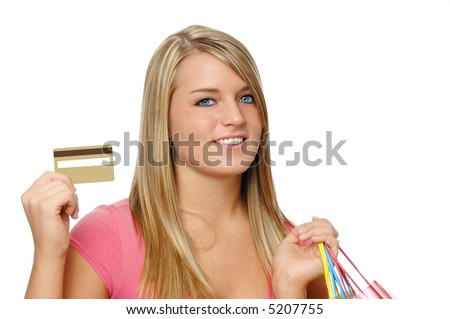 stock photo : Beautiful teen girl with blank credit card and shopping bags