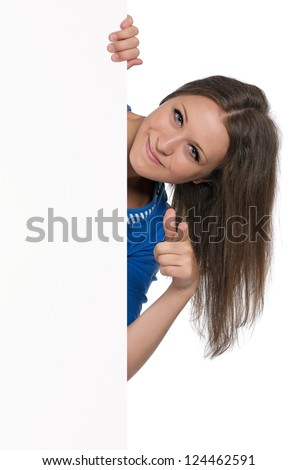 Beautiful teen girl with white blank isolated on white background