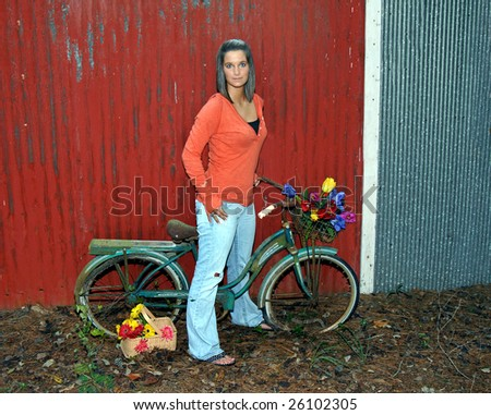 stock photo : Beautiful teen models besides a retro and rusting bicycle ...