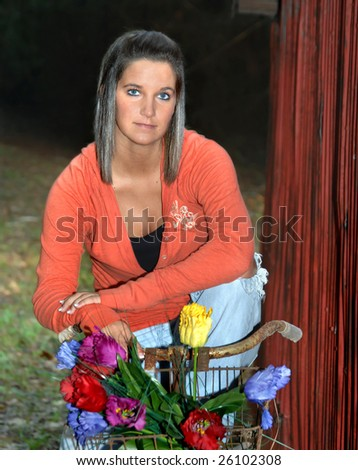 stock photo : Beautiful teen models sitting on a retro rusting bicycle ...