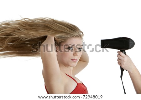 Beautiful teenage girl having her hair blown - stock photo