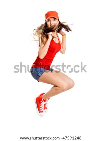 Beautiful teenage girl jumping of happiness isolated on white