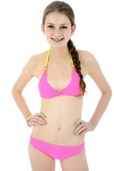 Beautiful teenage girl wearing a pink bikini in studio isolated on white