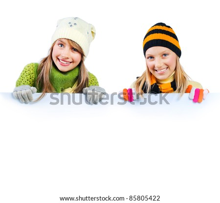 Beautiful Teenage Girls holding blank sign billboard. Space for Your Text