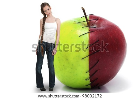 Beautiful teenage woman standing beside a whole red delicious apple with a nutrition label