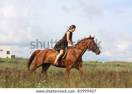 Beautiful teenager girl in brown dress and chestnut horse