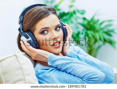 Beautiful teenager girl listening music. Face portrait.