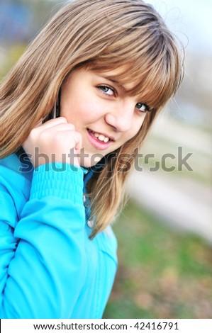 stock-photo-beautiful-teenager-girl-talking-by-cellular-phone-42416791.jpg