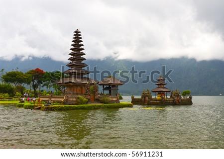 Beautiful temple on lake in extinct volcano crater, Pura Ulun Danu Bratan, Bali - stock photo