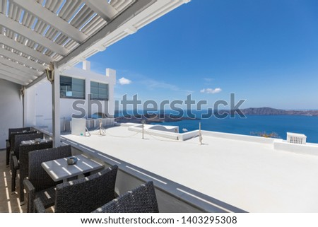 Beautiful terrace and caldera view. Amazing luxury vacation landcsape panorama, Santorini, Greece. White architecture and shadow by sunlight. Perfect summer holiday concept, idyllic scene #1403295308