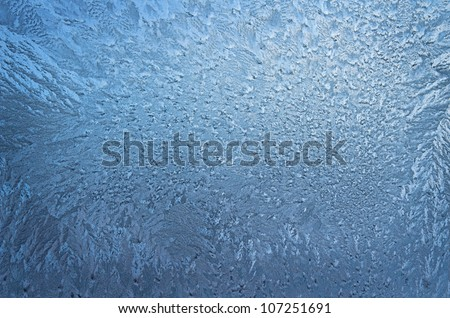 beautiful texture of frozen glass, blue color
