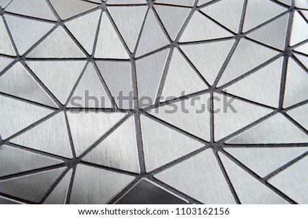 Beautiful texture of gray carved patterned plastic triangles with rounded corners and lines. The background. #1103162156