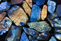 Beautiful texture of natural wet colorful labradorite gem stones.