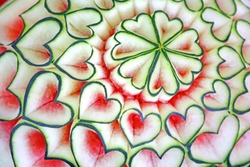 Beautiful Thai style carving watermelon in heart shaped. Royal Thai cuisine decorative style. Selective focus