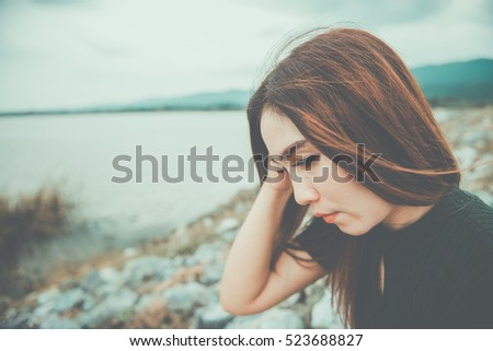Shutterstock Beautiful thai woman very sad from unrequited love,rethink,think over,vintage style,dark tone,broken heart,asian girl