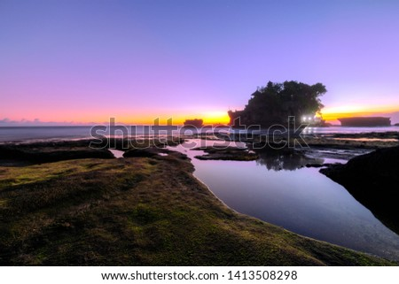 Beautiful Thanalot sunset seascape vivid color with reflection , Travel Bali, Indonesia