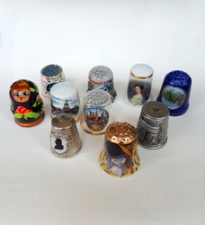 Beautiful thimbles. A small collection of thimbles from around the world. Assistant in sewing and embroidery. Decorative Souvenirs.