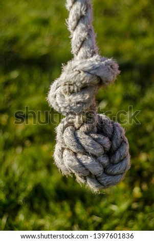 Beautiful thing and thing. Beautiful view and background on the end and knot of thick rope, cable and rope during the day and summer. #1397601836