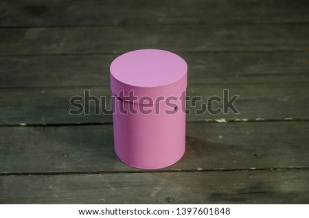 Beautiful thing and thing. Beautiful view of the round pink box and gift box on a wooden surface. #1397601848