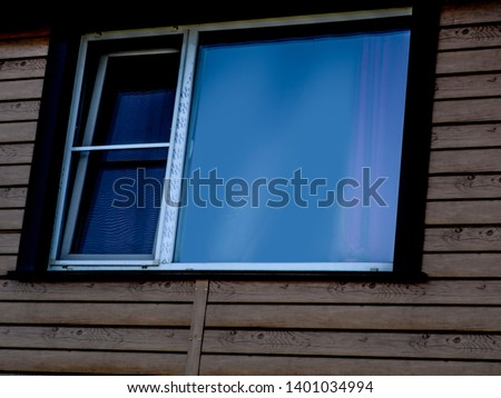 Beautiful thing and thing. Beautiful view of the window of an old wooden house. #1401034994