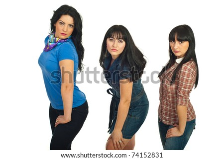 Beautiful three brunette woman standing in a row and posing isolated on white background