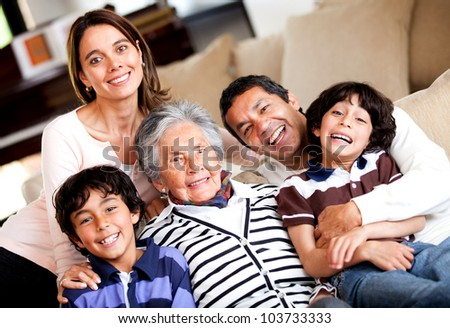 Beautiful three-generation family smiling at home