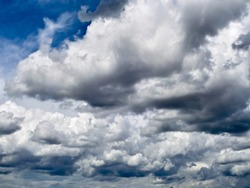 Beautiful thunderclouds. Fluffy volumetric clouds before a thunderstorm. The background symbolizes the power of nature. Image stock for design. Sky texture.