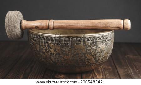 Beautiful tibetan singing bowl with stick on itself Stock foto ©
