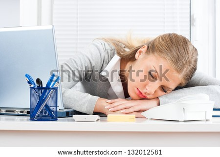 Beautiful tired business woman sleeping at work,Tired businesswoman
